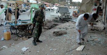 ATMOSPHERE OF FEAR: Security officials examine a bomb blast site on the outskirts of Quetta on August 12, 2009. — PHOTO: AFP