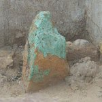The actual stone that was dropped on Kadu by a laborer. It has been preserved next to his grave