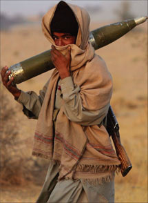 Force of arms A Baloch Marri tribesman carries a shell during clashes with Pakistani troops - PHOTO: GETTY IMAGES