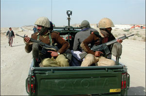 Wary Paramilitary forces on patrol in the lands of the Baloch Bugti tribe - PHOTO: AP