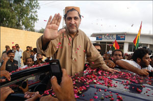 Rebel The BNP's Akbar Mengal greets supporters after an anti-terrorism court orders his acquittal - PHOTO: REUTERS