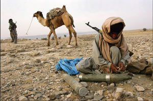 Battle-ready A Baloch Marri tribesman prepares BM-12 rockets during a clash with Pakistani troops - PHOTO: GETTY IMAGES