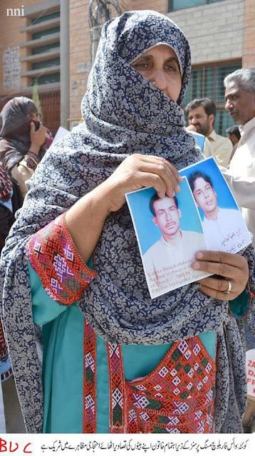Mother of Waheed (killed) and Kabeer (abducted) holding pictures of her sons victims of Pakistani state atrocity in Balochistan.