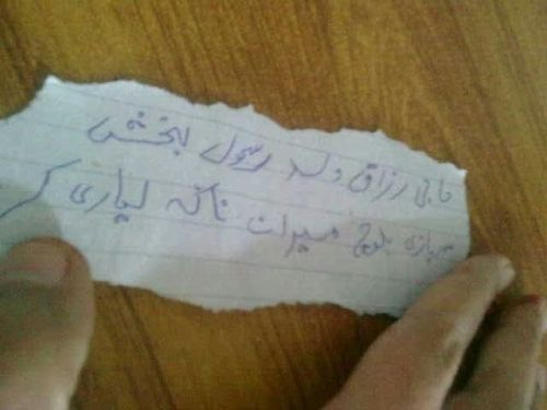 Here's the handwritten slip found near journalist Abdul Razzaq's body with his name on it.