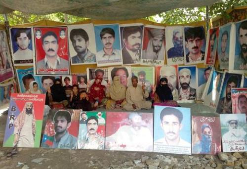 Photo showing ongoing hunger strike in Balochistan, August 11, 2013. The strike's leader, Mama Qadeer, sits in the middle. He is the father of a student activist, Jalil Reki Baloch, who was abducted and killed. Mama Qadeer stays in his tent all day, everyday, only eating at night. He attracts followers, who come and go.