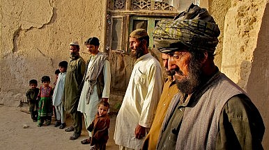 Several generations of Baloch line up in Kandahar, southeast Afghanistan