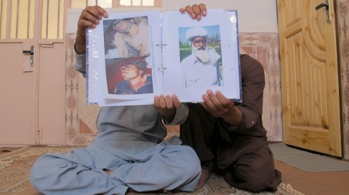 Karim and Sharif Baloch, both of them from Pakistan, show the portraits of their lost brother and father at their current residence in Zaranj. They tell IPS their relatives were killed in 2011 during a Pakistani military operation. Credit: Karlos Zurutuza/IPS
