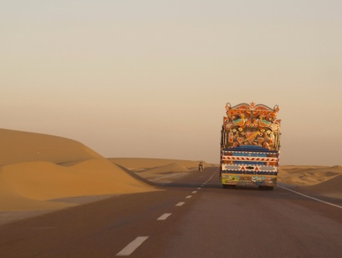 A truck travels down a lost road in Nimroz, the only Afghan province where the Baloch minority form a majority. In the country's remote southwest, Nimroz shares a 500-kilometre border with both Iran and Pakistan. Credit: Karlos Zurutuza/IPS