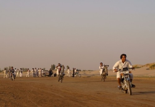 Baloch youngsters ride their motorbikes along the dry bed of the Helmand River. The total lack of economic and social opportunities pushes them to illegally migrate to neighbouring Iran, seeking a better life. Credit: Karlos Zurutuza/IPS