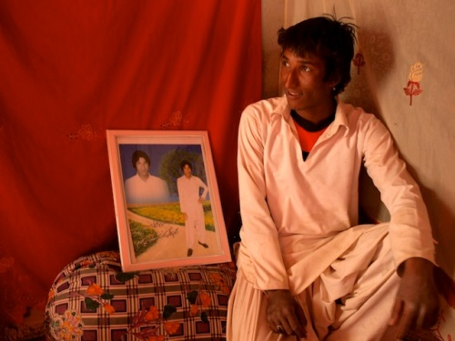 A Baloch teenager poses next to his portrait inside his house in Nasirabad, another mud-hut village in Afghanistan's Nimroz province. Like the majority of the local population, he is also illiterate. Credit: Karlos Zurutuza/IPS