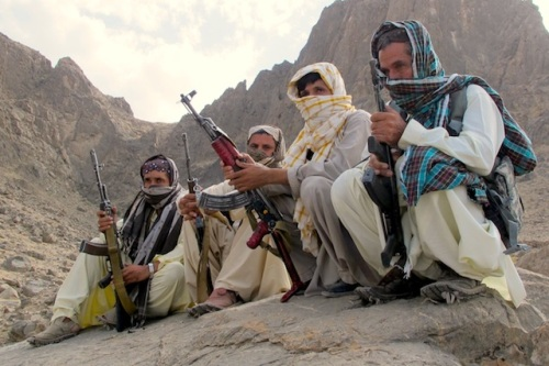 Baloch fighters from the Balochistan Liberation Army crouch at an undisclosed location along the Afghan-Pakistan border. There are several Baloch insurgent groups fighting for independence in Pakistan. Some of their fighters often cross the border to evacuate the wounded and treat them in Afghan hospitals. Credit: Karlos Zurutuza/IPS