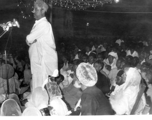 Mir Ali Ahmed Talpur addressing a public meeting. Miss Jinnah seen seated. Hyderabad 1964.