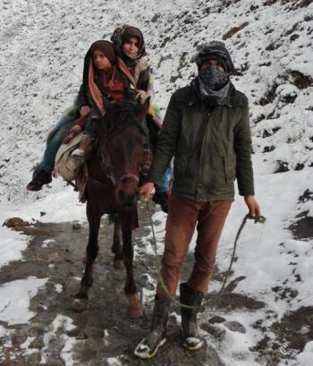 Omera and one of her sons on horseback during her journey from Pakistan to Greece