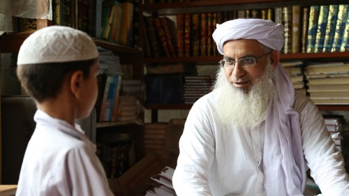 Abdul Aziz Ghazi, head cleric of the Red Mosque, quizzes one of his newest students. Photo by Adil Sheryar.
